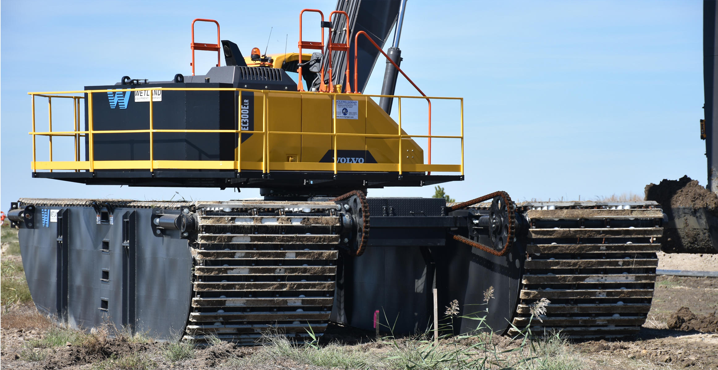 The Volvo EC300E excavator's standard crawler tracks were replaced with custom flotation pads, enabling it to operate in the cell without sinking.