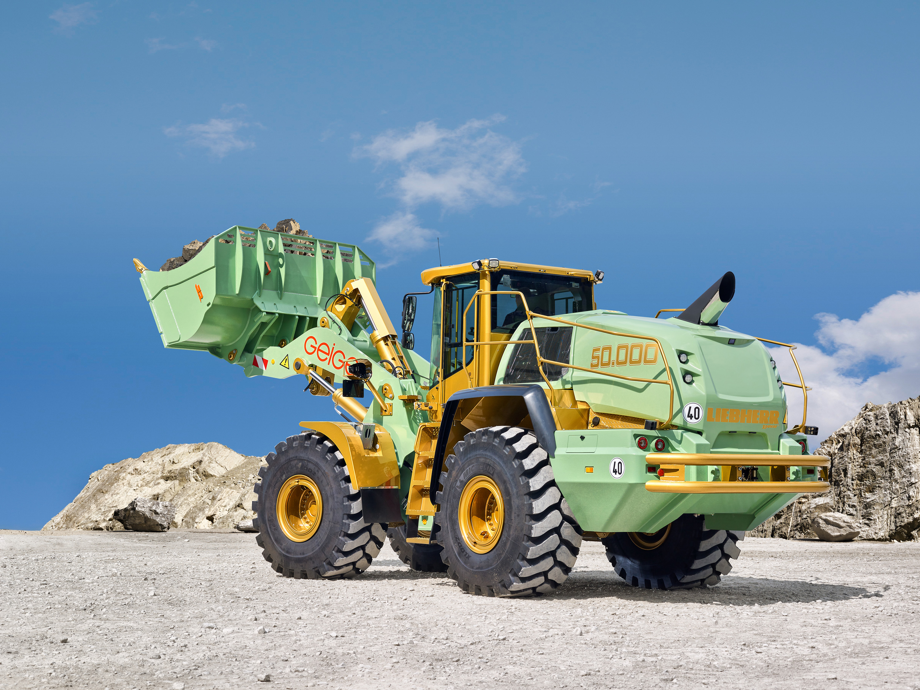 Geiger Unternehmensgruppe uses the 50,000th Liebherr wheel loader for transportation purposes at a quarry in Wertach, Southern Germany.