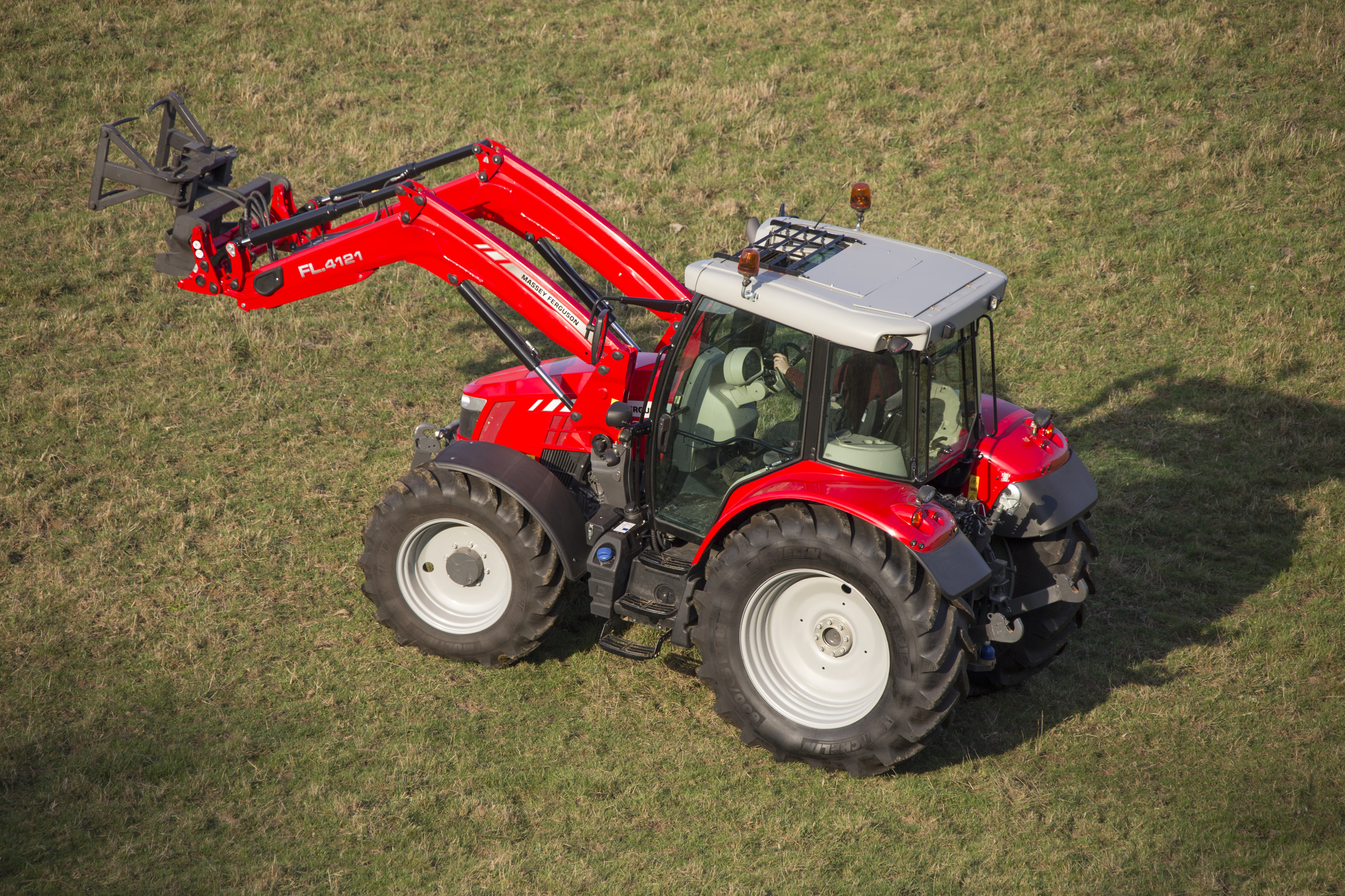 Massey Ferguson Global Series Visioline roof option further improves visibility for loader operations. MF 5713 with MF FL.4121 - developed for the demanding 60 - 130hp multi-purpose sector.