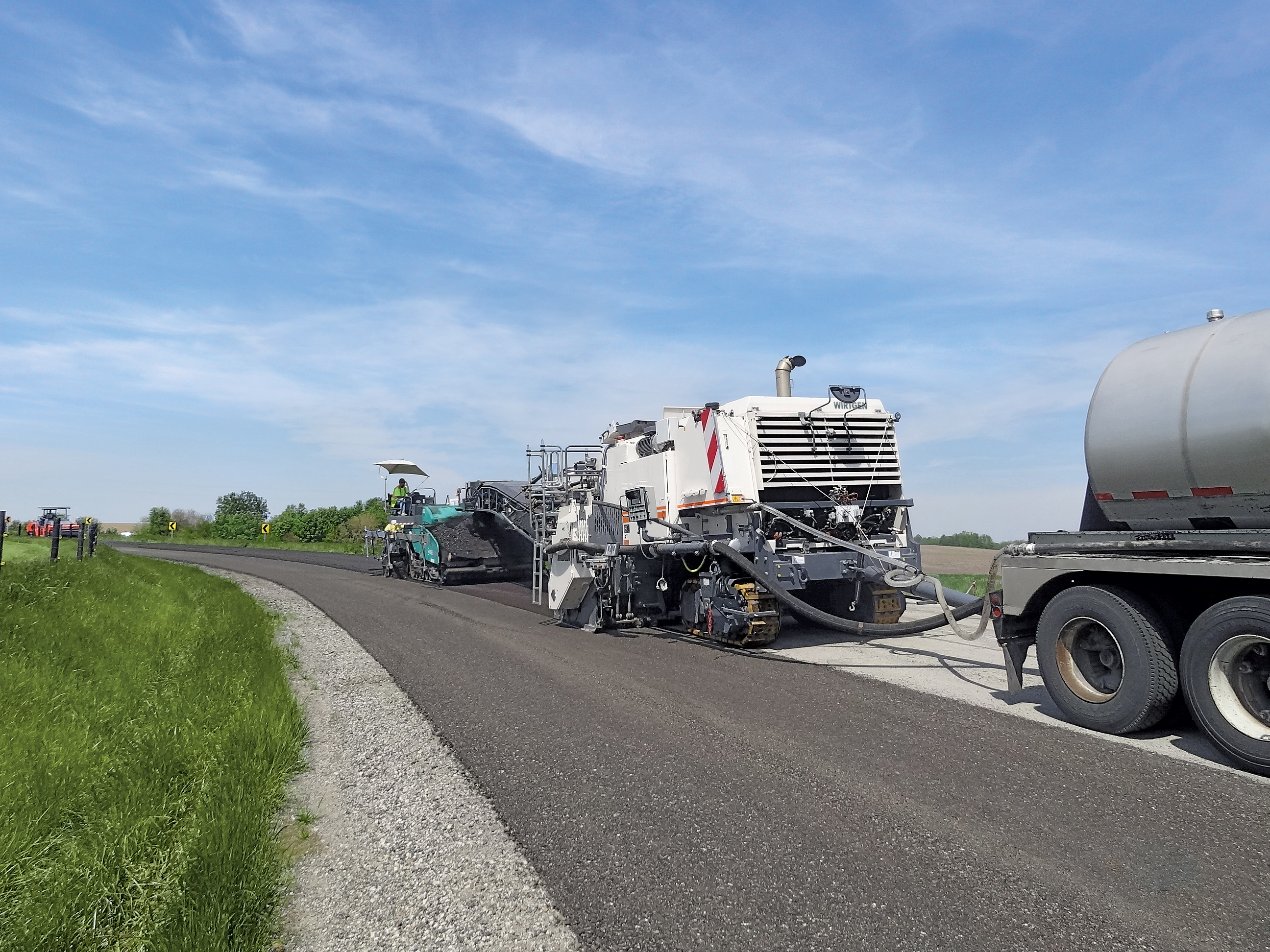 The Wirtgen 3800 CR seamlessly processes 12 ft., 6 in. (3,8 m) wide lanes in one pass. Adding binding agents, the powerful cold recycler quickly and economically transforms damaged asphalt courses in-place into high-grade, precompacted base courses, all with minimum disruption to traffic.
