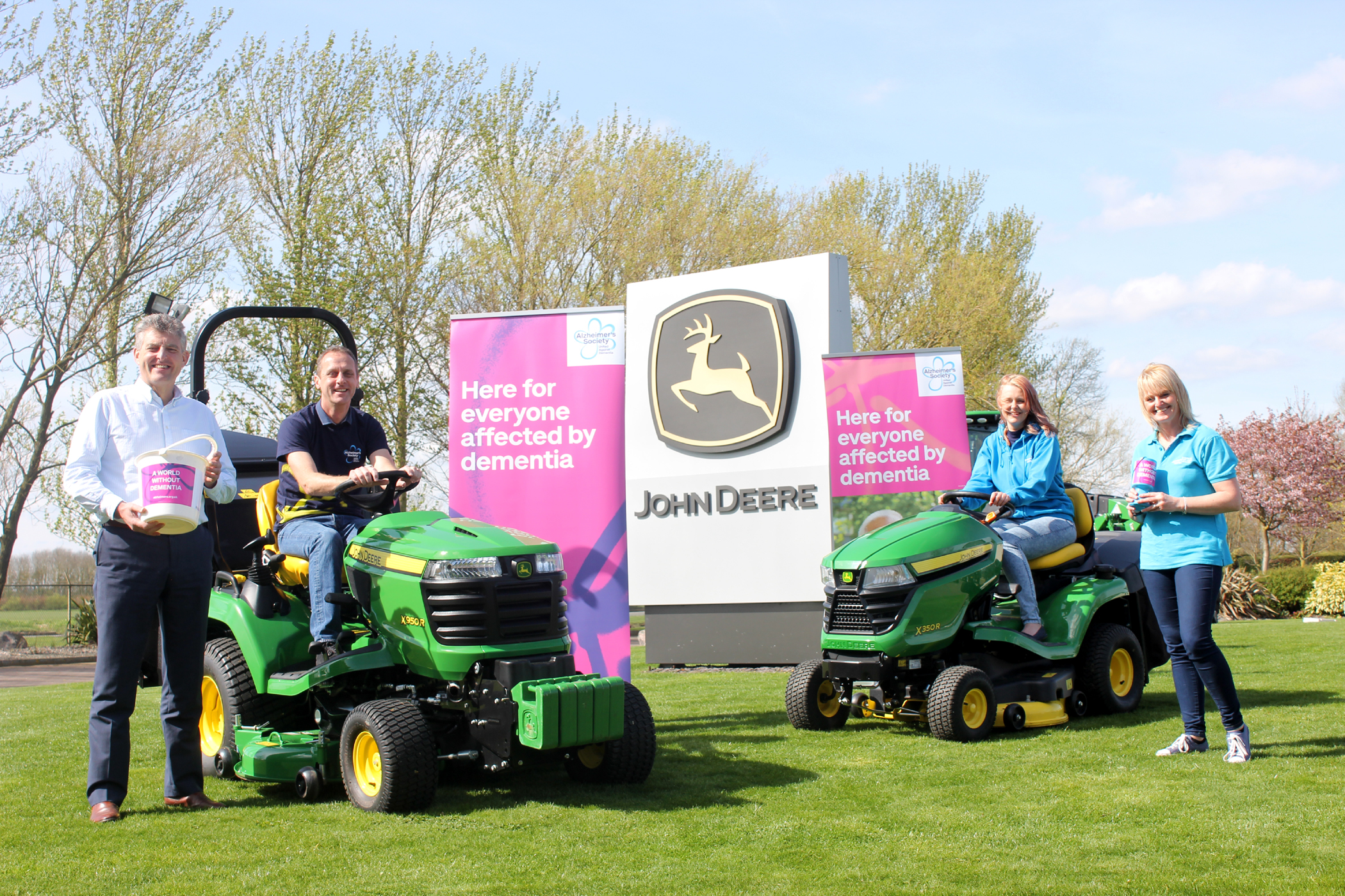 (Left to right): John Deere Limited turf division manager Chris Meacock, Andy and Kathryn Maxfield, and Alzheimer's Society regional community fundraising officer Sue Swire.
