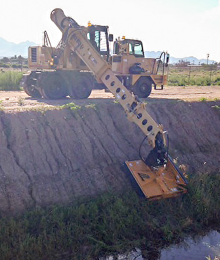 Boom extension along with mower and ditching bucket expand Municipality's usage of XL 4100 IV