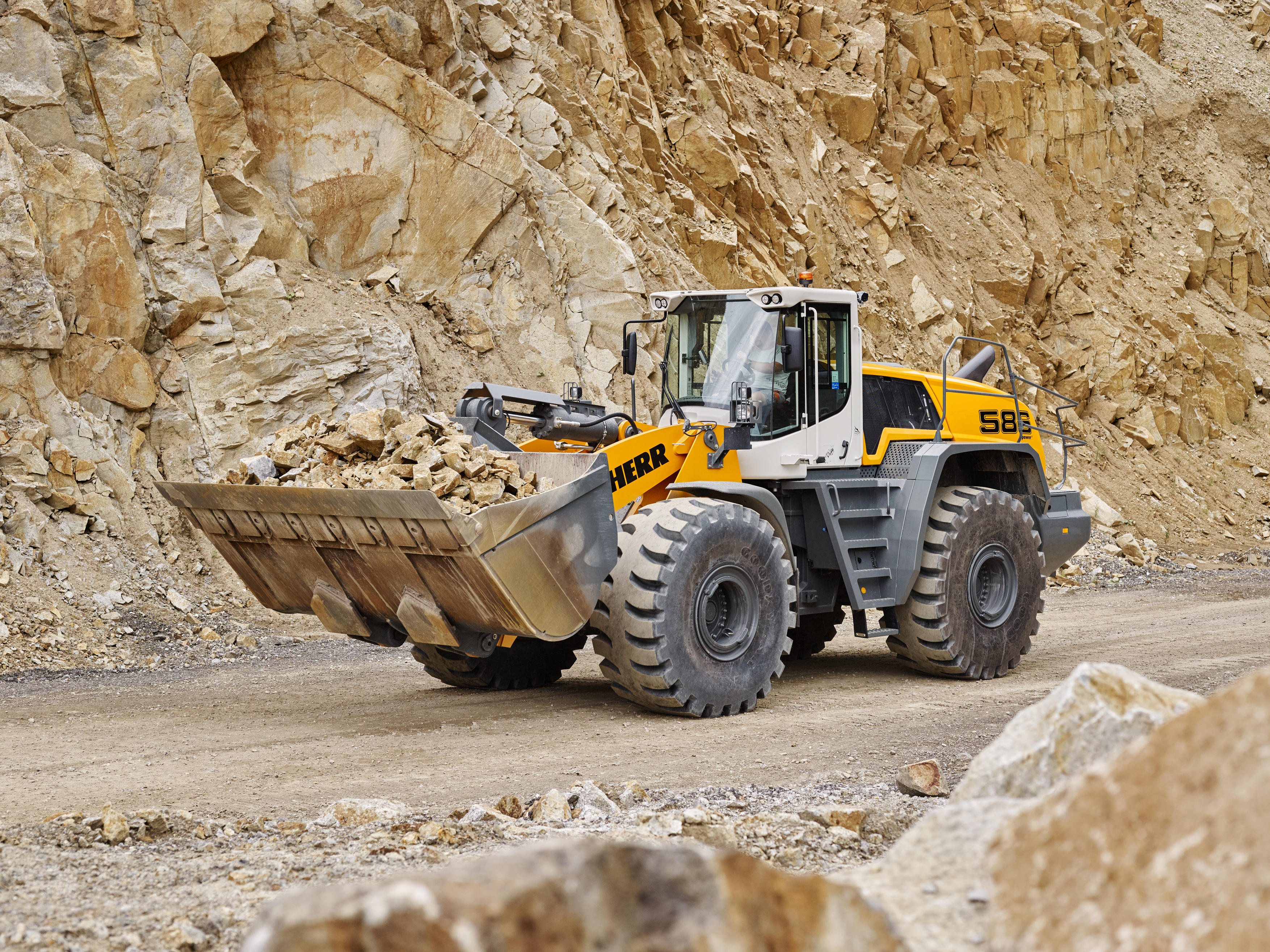 The L 586 XPower® the new Stage IV / Tier 4f compliant generation of large wheel loaders from Liebherr. The standard version, with an operating weight of 71,870 lb, has a tipping load of 47,620.