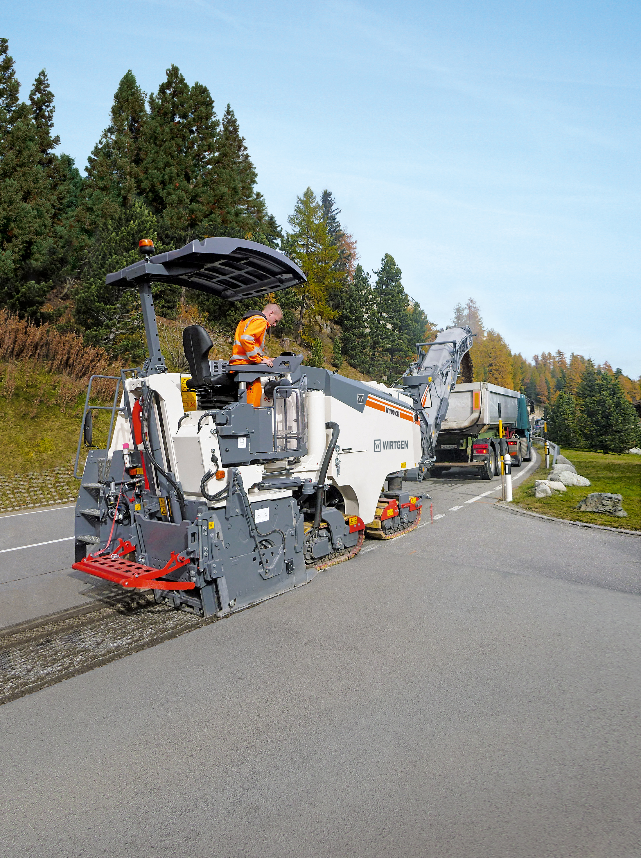 The new Wirtgen W 100 CFi in the Compact Class, with its 3 ft., 3 in. (1-m) working width and 0 – 13-in. (0 - 330-mm) working depth, masters every application, such as milling off pavement layers or milling tie-ins on road rehabilitation projects. With its modified machine weight and compact dimensions, it can be easily transported without a special permit.